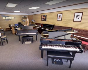 Interior of Piano Emporium with dozens of pianos on display